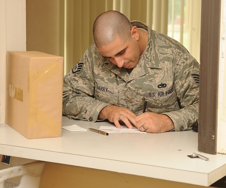 Staff Sgt. Thomas Barry, 4th Equipment Maintenance Squadron unit deployment manager, fills out an express mail label on Seymour Johnson Air Force Base, N.C., July 24, 2009. Created in the 1980s, express mail is a money-back overnight guarantee service offering tracking, proof of delivery, and insurance up to $100. Items shipped using this service can be delivered within 1 to 2 business days. (U.S. Air Force photo by Airman 1st Class Whitney S. Lambert)
