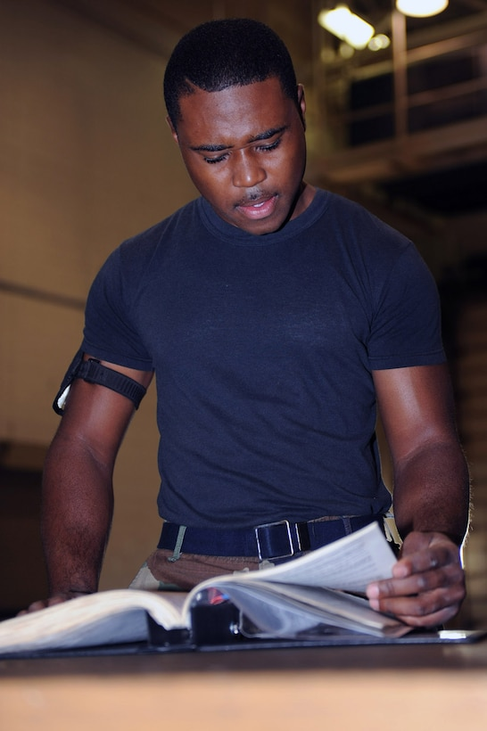WHITEMAN AIR FORCE BASE, Mo. - Senior Airman Quintellis Darden, 509th Maintenance Squadron Aerospace Ground Equipment Mechanic, checks the book before he performs maintenance on a diesel welder. AGE mechanics perform anywhere between 40 to 60 hours of maintenance a week in support of the B-2 mission. (U.S. Air Force photo/ Senior Airman Jason Huddleston)