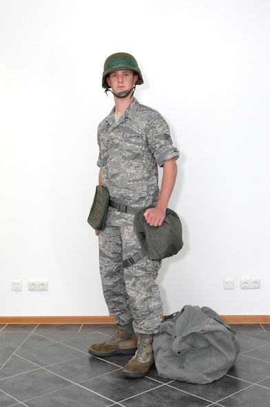 SPANGDAHLEM AIR BASE, Germany -- Senior Airman Benjamin Wilson, 52nd Fighter Wing Public Affairs Office, dresses in Mission Oriented Protective Posture 0.  People need to wear their individual protective equipment in MOPP 0 and carry their protective mask.  Field gear is worn as directed.  Aircrew will carry their protective mask. (U.S. Air Force photo by Master Sgt. Bill Gomez)