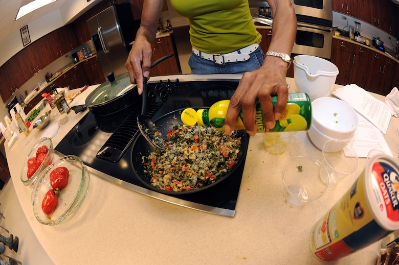 BUCKLEY AIR FORCE BASE, Colo. – Sandy Jefferson pours lemon juice on a stir-fry during a Healthy Heart Cooking Demonstration class. Limiting the amount butter and cooking fat in foods makes for a healthier dining experience. (U.S. Air Force photo by Senior Airman John Easterling)
