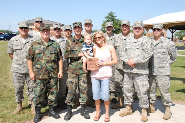 Members of the 180th engine shop remembered 2nd Lt. David Mitchell by purchasing a brick that was placed by his wife, Kristi and their son, Brayden at the 180th flag pole in front of the wing headquarters building.