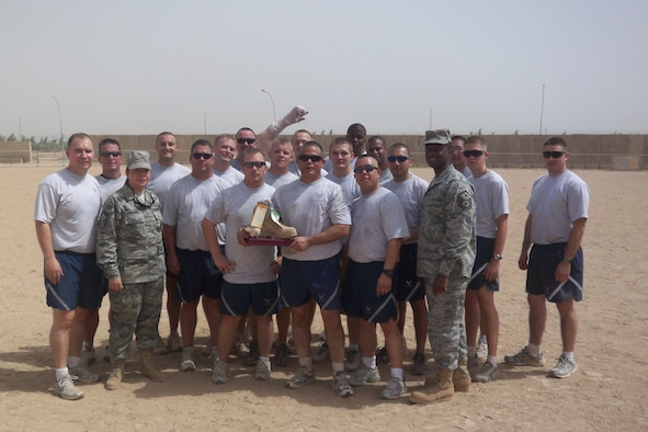 WRIGHT-PATTERSON AIR FORCE BASE, Ohio – Maj. John Marang, 1st Lt. Sean Donelan, and Tech. Sgt. Daniel Fitzgerald, all from the 87th Aerial Port Squadron, currently deployed with the 332nd Expeditionary Logistics Readiness Squadron, Joint Base Balad, played for the 332nd ELRS team during the 332nd Expeditionary Mission Support Group inaugural four squadron softball tournament in July.  The 332nd ELRS team beat the 332nd Expeditionary Force Support Squadron in the first game 18-3 and went on to beat the 332nd Expeditionary Civil Engineer Squadron in the championship game 16-12. More than 60 reservists from the 87th APS are currently serving at Joint Base Balad.  (courtesy photo)