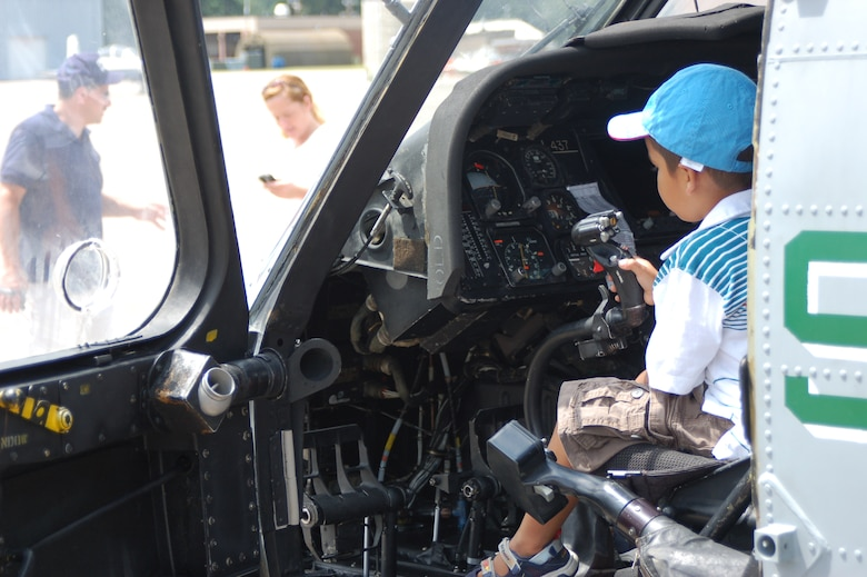 """A potential future recruit takes over the control stick in an SH-60R """"Seahawk"""" that was one of several choppers on display during a Space and Aviation Day open House at Bradley ANG Base, East Granby, Conn. July 18, 2009. (U.S. Air Force photos by Tech. Sgt. Joshua Mead)"""