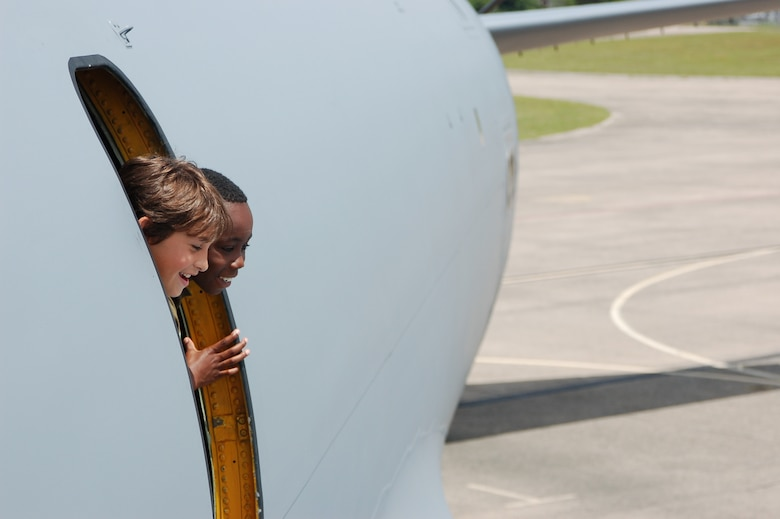 Kwame Hammond Jr. , 10, peeks out the side hatch of a KC-135 along with his friend, Elijah, 9, at Space and Aviation Day at Bradley ANG Base, East Granby, Conn. July 18, 2009. (U.S. Air Force photos by Tech. Sgt. Joshua Mead)