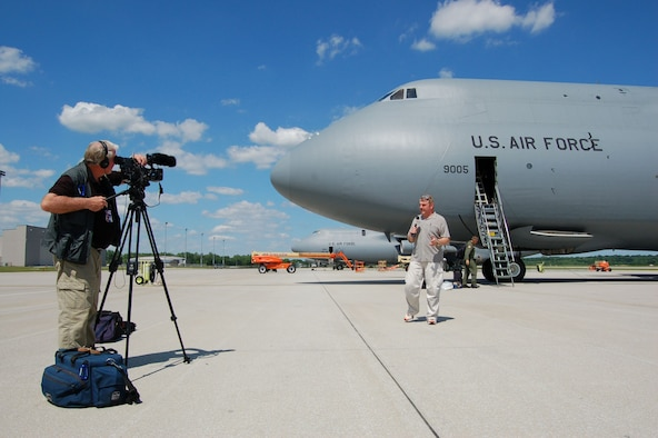 WRIGHT-PATTERSON AFB, Ohio - Channel 2 reporter Dan Edwards and cameraman Donald Hatcher are filming in front of a 445th Airlift Wing C-5 Galaxy during a media flight to Southwest Asia covering the 445th Airlift Wing mission. (Air Force photo/Maj. Jose Cardenas)