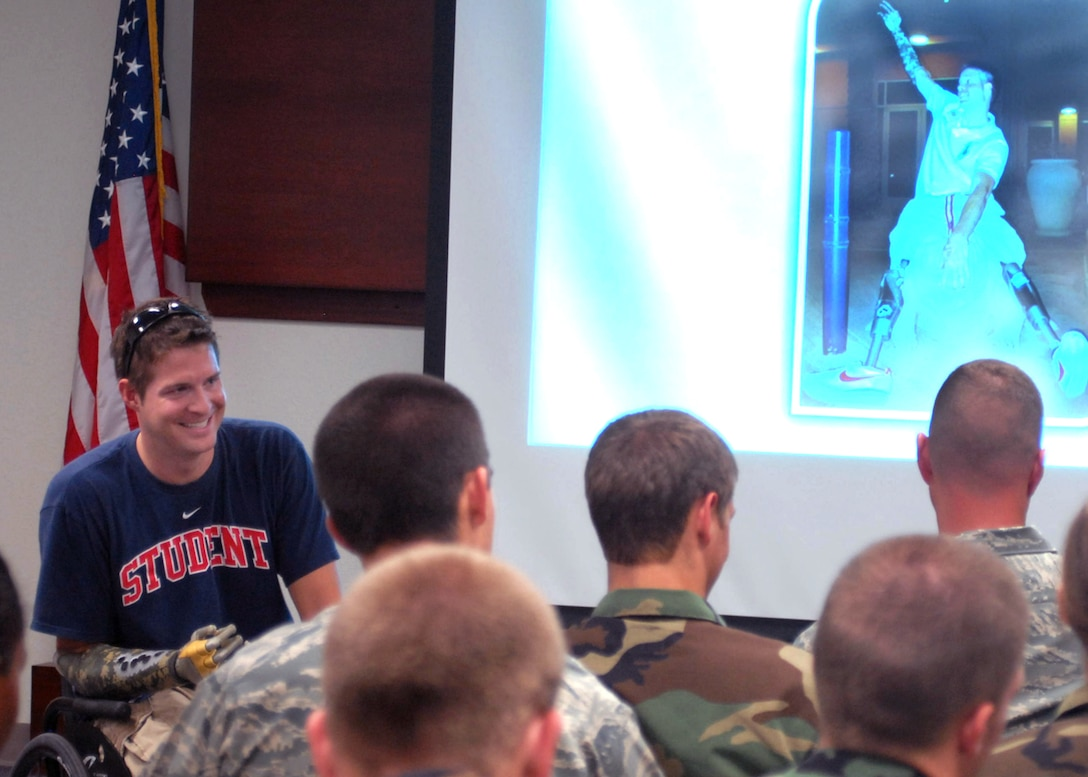 Brian Kolfage Jr. speaks to an audience that included 17th Security Forces Squadron defenders and ROTC cadets July 2 at Goofellow Air Force Base, Texas. He spoke about a rocket attack in Iraq on Sept. 11, 2004, which left him without legs and a right arm. Mr. Kolfage is a former 17th Security Forces Squadron defender and now a retired senior airman. (U.S. Air Force photo/Robert D. Martinez)