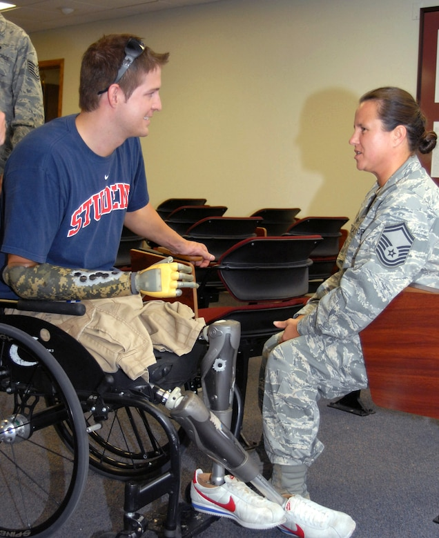 Brian Kolfage Jr. speaks to Senior Master Sgt. Annette Whitenack July 2 at Goodfellow Air Force Base, Texas. Mr. Kolfage spoke about his experience on Sept. 11, 2004, when a rocket attack left him without legs and a right arm. Sergeant Whitenack was one of the first medical responders on scene after he was injured. Mr. Kolfage is a former 17th Security Forces Squadron defender and now a retired senior airman. (U.S. Air Force photo/Robert D. Martinez)
