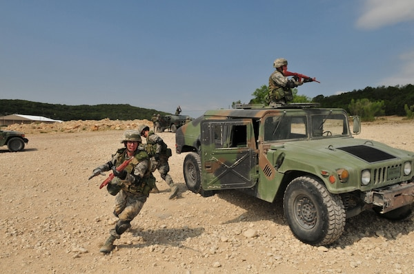Security forces students exit a Humvee during basic combat convoy field training at Camp Bullis. Camp Bullis, a training camp located in northwest San Antonio, is used primarily as maneuvering grounds for Army, Air Force and Marine combat units. (U.S. Air Force photo/Patrick Nugent)