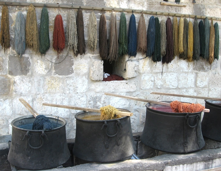 Wool is dyed in different colors made from color extracted from flowers, roots and insects for hours before it is hung to dry. Natural materials are more durable than synthetic materials so good quality Turkish rugs are made from the finest silk, bred sheep and naturally picked cotton. (U.S. Air Force photo/Airman 1st Class Amber Ashcraft)