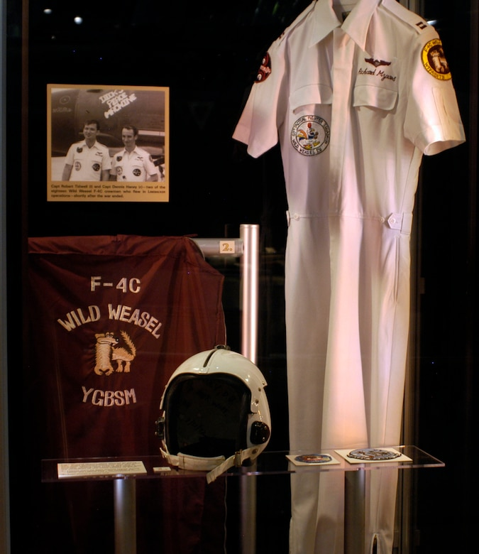 DAYTON, Ohio - Capt. Richard Myers' Wild Weasel IV party suit. Capt. Myers was an F-4C pilot who flew Linebacker missions over North Vietnam. Myers later rose to the rank of four star general, and from 2001-2005 was the Chairman of the Joint Chiefs of Staff. Also in the exhibit case is a helmet worn by Capt. Dennis Haney during Linebacker operations. On combat missions, the helmet had a camouflaged cover. And, Capt. Haney's travel bag. (U.S. Air Force photo)