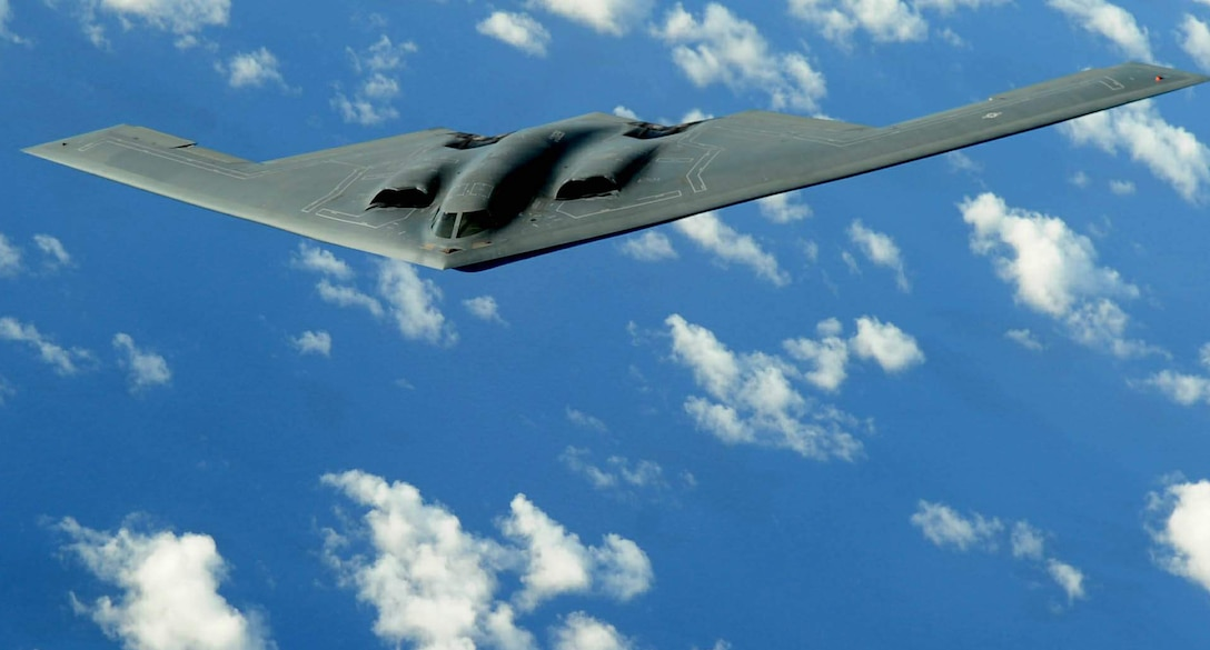 A B-2 Spirit deployed to Andersen Air Force Base, Guam, flies a training mission over the Pacific in support of the continuous bomber presence. This bomber was one of four aircraft to complete 700 flying hours during the three-month deployment from Whiteman Air Force Base, Mo. (U.S. Air Force photo/Senior Airman Christopher Bush)