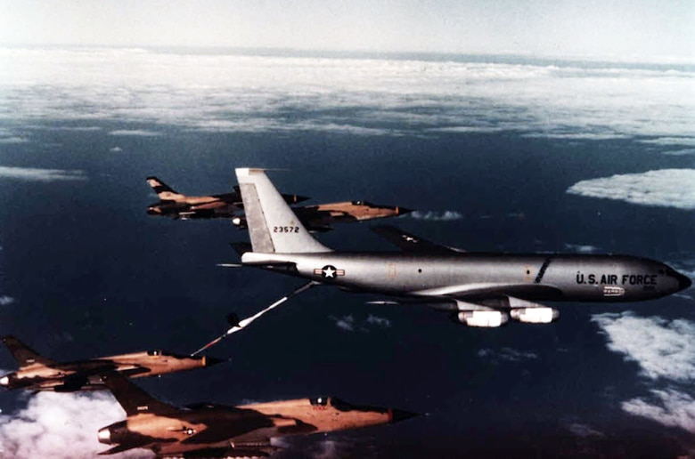 One of a flight of F-5A Freedom Fighter, armed with 500-pound bombs, refuels from a KC-135 tanker somewhere over Vietnam in February 1966.