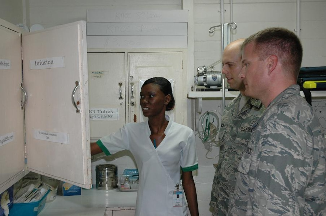 GEORGETOWN, Guyana -- Alicia Moinson, an emergency room nurse at Georgetown's Mercy Hospital, explains types of medical equipment available during emergencies to Dr. (Capt.) Andrew Muck, inset and Dr. (Capt.) Adam Balls during a hospital tour Monday. (U.S. Air Force photo by Kevin Walston)