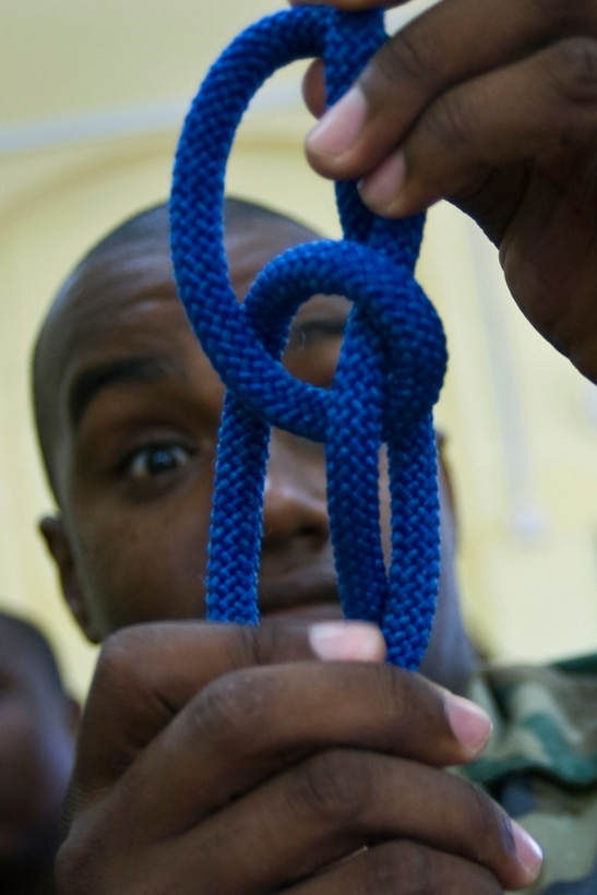 Constable Issac Gustav of the Royal St. Lucia police force's special service unit successfully ties a figure eight  knot during a subject matter expert exchange on basic rappelling for Operation Southern Partner June 1 in La Toc, St. Lucia.  (U.S. Air Force photo/Staff Sgt. Bennie J. Davis III)