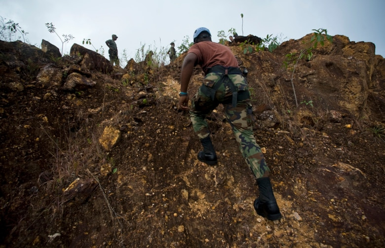 Members of the Royal St. Lucian police force's special wervice unit make their way up a step incline to execute basic mountaineering rescue procedures learned during Operation Southern Partner June 1 at La Toc, St. Lucia. (U.S. Air Force photo/Staff Sgt. Bennie J. Davis III)