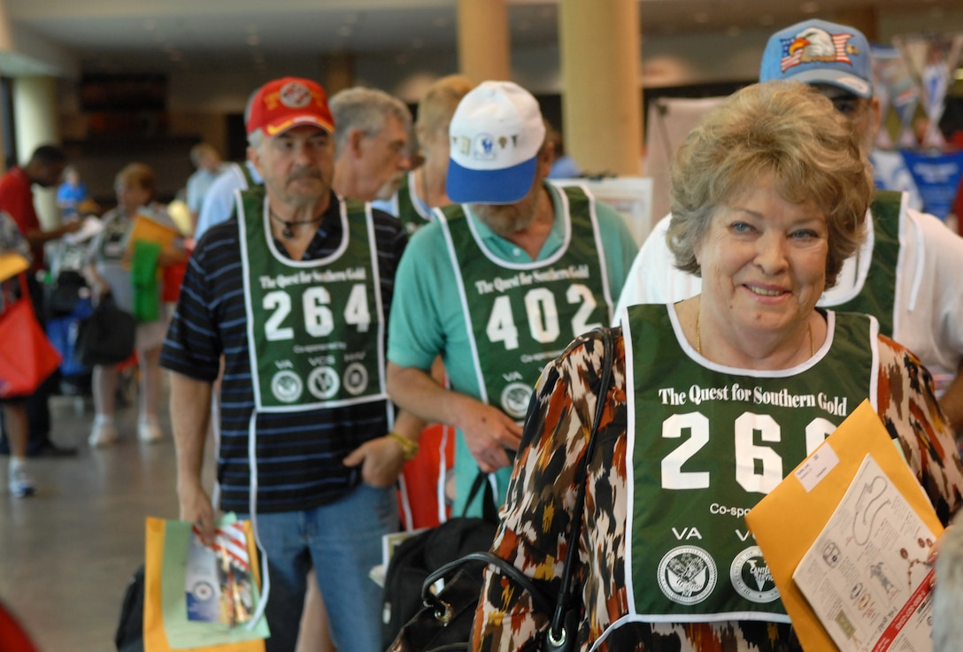 Judy Tarter, a 73-year-old Navy veteran, walks through the registration line for the 23rd Annual National Veterans Golden Age Games June 1 in Birmingham, Ala. Nearly 700 senior veterans, ages 55 and older, registered to participate in the athletic competitions here.  (Defense Department photo/Army Sgt. 1st Class Michael J. Carden)