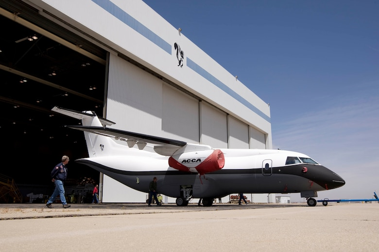 The Advanced Composite Cargo Aircraft is rolled out of a hangar in May 2009 at Lockheed Martin's Skunk Works, U.S. Air Force Plant 42 in Palmdale, Calif. The ACCA is a modified Dornier 328J aircraft.  The fuselage aft of the crew station and the vertical tail were removed and replaced with completely new structural designs made of advanced composite materials fabricated using out-of-autoclave curing.  Air Force Research Laboratory at Wright-Patterson Air Force Base, Ohio oversees the ACCA program. (Lockheed Martin photo)