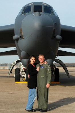 Maj. Maury Kent, 917th Wing Operations Support Flight, wing weapons officer, Barksdale Air Force Base, La., poses in front of a B-52 Stratofortress on the ramp with his wife Cheryl at Barksdale AFB, Dec. 6, 2008. Maj. Kent recently made a move from the 93rd Bomb Squadron to the 47th Fighter Squadron. After training on the A-10 Thunderbolt, Maj. Kent will return the here as a fighter pilot for the 47th FS. (Courtesy photo)