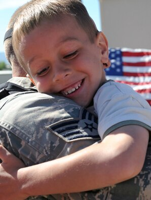Brayden Flink hugs his father, Staff Sgt. Jacob Flink, a 419th Aircraft Maintenance Squadron crew chief, upon his return to Hill Air Force Base, Utah, May 28, 2009. Sergeant Flink was among nearly 300 Airmen from the 419th and 388th Fighter Wings who returned after a four-month deployment in support of Operation Iraqi Freedom. (U.S. Air Force photo/Staff Sgt. Kyle Brasier)