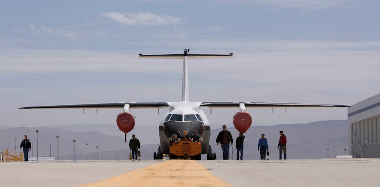 The Advanced Composite Cargo Aircraft rolls out of a hangar in May at Lockheed Martin's Skunk Works plant in Palmdale, Calif. The ACCA is a modified Dornier 328J aircraft. The fuselage aft of the crew station and the vertical tail were removed and replaced with completely new structural designs made of advanced composite materials fabricated using out-of-autoclave curing. Air Force Research Laboratory officials at Wright-Patterson Air Force Base, Ohio, oversee the ACCA program. (Courtesy photo)