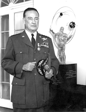 Gen. T.D. White and the trophy that bears his name. He is shown here wearing the Distinguished Service Medal, awarded for a career of outstanding leadership.(U.S. Air Force photo)