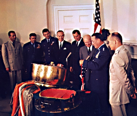 The Discoverer reconnaissance satellites heralded an era of powerful USAF space capabilities. In this photo, Gen. T.D. White presents an American flag flown on Discoverer XIII to President Dwight Eisenhower. (U.S. Air Force photo)