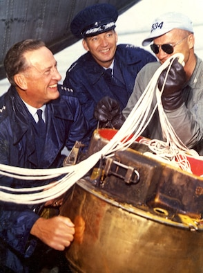 Gen. T.D. White (left) after the successful mid-air recovery of Discoverer XIII, the first man-made object recovered from orbit, in 1960. It was the forerunner of many successful Air Force satellites. (U.S. Air Force photo)