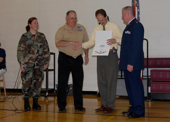 Staff Sgt Karla Belliveau, Mr. Earl Bonett (Western MA ESGR Chair), and Maj. Steve Dougherty (104 FW Civil Engineering Commander), present Ms. Sue Frederick and Mr. Richard Bedard the ESGR recognition awards during the school's Memorial Day ceremony. (photos by Capt. Matthew T. Mutti)