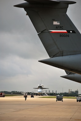 "Space Shuttle Atlantis made a pit-stop, to a parking area near the 433rd Airlift Wing at Lackland AFB, Texas, today (June 2, 2009). The shuttle is on its way home to Kennedy Space Center, Fla., from the landing site at Edwards AFB, Calif. According to Ms. Candrea Thomas, public affairs officer at NASA's Kennedy Space Center, Atlantis was returning from ""STS Mission 125"" where the crew serviced and upgraded the Hubble Space Telescope on the International Space Station. Weather caused a delay and relocation of the landing site. After landing at Edwards AFB, Atlantis was ""piggybacked"" onto a modified Boeing 747 called a shuttle carrier. The 747 then flew from Edwards to El Paso, Texas and spent the night waiting for severe thunder storms to pass. Next stop was the Lackland AFB flight line. The shuttle carrier took on fuel while parked near the Alamo Wing""s C-5 Galaxy parking ramp. From here, the shuttle plans a stop in Columbus, Ohio and is expected back in Florida early in the evening. (U.S. Air Force Photo/Master Sgt. Collen McGee)"