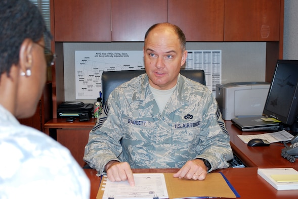 Chief Master Sgt. Dwight D. Badgett, command chief master sergeant for Air Force Reserve Command, speaks with Senior Master Sgt. Cathy Williams, special assistant to the command chief, about items of interest to Airmen at the command headquarters at Robins Air Force Base Ga. Chief Badgett advises the commander on all matters concerning the health, morale, welfare and effective utilization of enlisted Airmen at 66-plus locations. (U.S. Air Force photo/Staff Sgt. Celena Wilson)