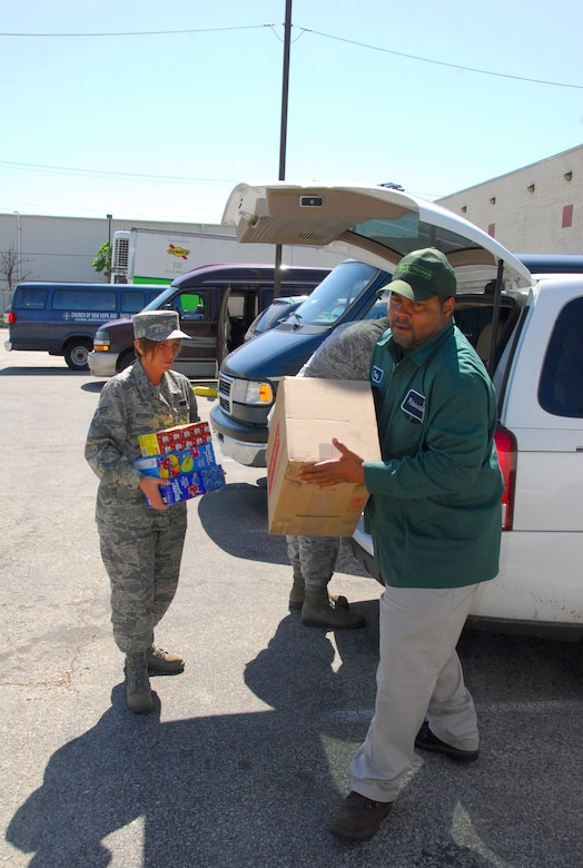 Senior Airman Danielle K. Heidrick and SMSgt Scot A. Baughman, and members of the 111th Fighter Wing's Enlisted Field Advisory Council (EFAC) deliver food items and a check collected from 111th FW personnel at the last EFAC event to Philabundance on May 21.  Philabundance is the Delaware Valley's largest food bank and hunger relief organizations serving 600 neighborhoods in 10 counties.