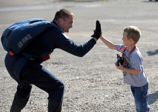 Lt. Col. Aldru Aaron of The U.S Air Force Academy's Wings of Blue Parachute Team, pauses for a fan and makes a new friend with Robert Ferrozzo, who was part of a tour of over 300 who were treated to a demonstration jump over the Utah Test and Training Range (UTTR), June 3.
