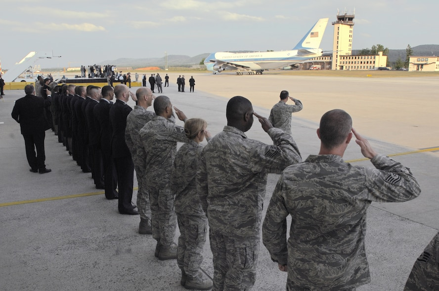 Airmen at Ramstein Air Base, Germany, salute Air Force One June 5 as it taxis for takeoff.  President Barack Obama had stopped at Ramstein en route to nearby Landstuhl Regional Medical Center to visit wounded U.S. servicemembers being treated there. (U.S. Air Force photo/Senior Airmen Kenny Holston)