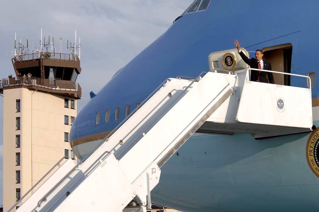 President Barack Obama waves to the crowd June 5 from Air Force One at Ramstein Air Base, Germany. He was visiting wounded U.S. servicemembers being treated at nearby Landstuhl Regional Medical Center, Germany.  (U.S. Air Force photo/Senior Airman Kenny Holston)