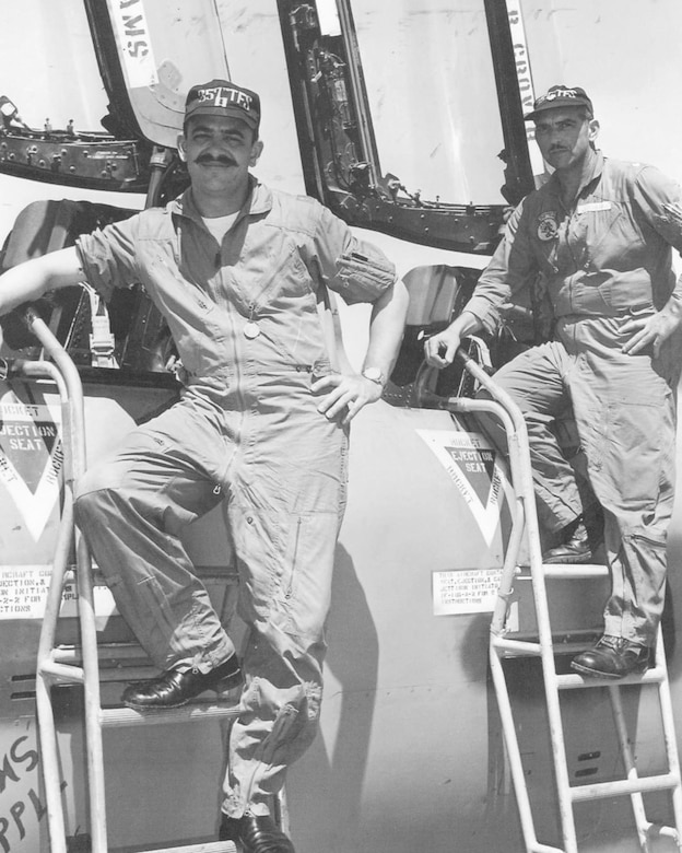 """Capt. Billy Sparks (left), pilot, and Maj. Carlo Lombardo (right), electronic warfare officer, with the 355th Tactical Fighter Wing, Takhli, in 1967. Lombardo, also known as """"Grouchy Bear,"""" often said to Sparks, """"All of the brains are in the back seat and all of the decisions are in the front seat!"""" (U.S. Air Force photo)"""