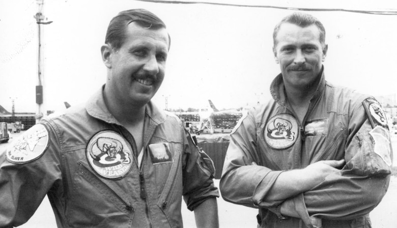 On April 23, 1967, Capt. Jerry Hoblit (l), pilot, and Capt. Tom Wilson (r), EWO, flew No. 3 in a four aircraft Wild Weasel formation on a strike against the heavily-defended area around Thai Nguyen, North Vietnam. Dodging three SA-2s, Hoblit and Wilson bombed one SAM site and fired their Shrikes against another. When an SA-2 missile damaged the lead aircraft, Hoblit and Wilson kept the SAM crew's attention by engaging it, dodging yet another SA-2. Hoblit and Wilson then remained behind to cover the crew of an RF-4C that had been shot down before the strike.  None of the strike aircraft were lost. For their valor and daring, Capt. Hoblit was awarded the Air Force Cross, and Capt. Wilson was awarded the Silver Star. (U.S. Air Force photo)