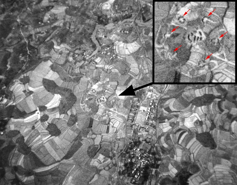 Taken over North Vietnam in January 1967, this photograph illustrates the difficulty of visually spotting a SAM site. Wild Weasels used specialized electronic equipment to find the SAM sites. Red arrows in closeup point to the six SA-2 launchers in revetments. (U.S. Air Force photo)