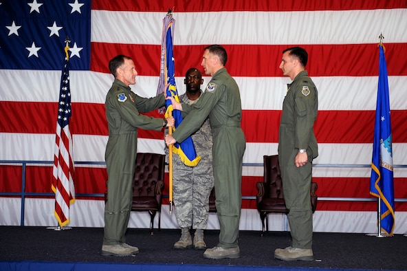 Col. Scott Vander Hamm, outgoing 28th Bomb Wing commander, hands the guidon to Lt. Gen. Norman Seip, 12th Air Force commander, during the change of command ceremony here, June 4. The handing off of the guidon symbolizes Col. Vander Hamm relinquishing command to the incoming 28 BW commander Col. Jeffrey Taliaferro. (U.S. Air Force photo by Airman 1st Class Corey Hook)