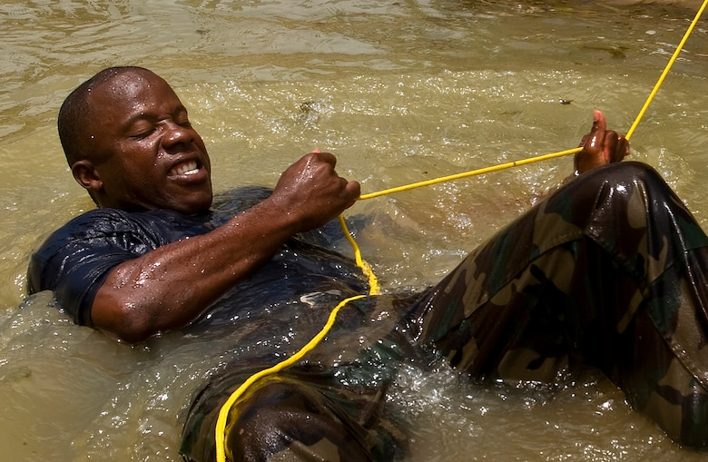 Constable Allen Abbott of the Royal St. Lucia Police Force's Special Service Unit tries to pull himself to shore while practicing swift-water rescue procedures that were taught by U.S. Air Force pararescuemen June 5 during Operation Southern Partner at La Toc, St. Lucia. Operation Southern Partner is a long term commitment between U.S. and partner nations to share experiences, information, vital skills, tactics and techniques in preparation for future regional challenges that require cooperative solutions.  (U.S. Air Force photo/Staff Sgt. Bennie J. Davis III)