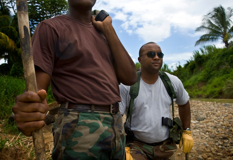 Constables Jameson Jeremy and Alphonse Cyril, members of the Royal St. Lucia Police Force's Special Service Unit, listen to instructions before practicing swift-water rescue procedures that were being taught by U.S. Air Force pararescuemen June 5 during Operation Southern Partner at La Toc, St. Lucia. Operation Southern Partner is a long term commitment between U.S. and partner nations to share experiences, information, vital skills, tactics and techniques in preparation for future regional challenges that require cooperative solutions.  (U.S. Air Force photo/Staff Sgt. Bennie J. Davis III)