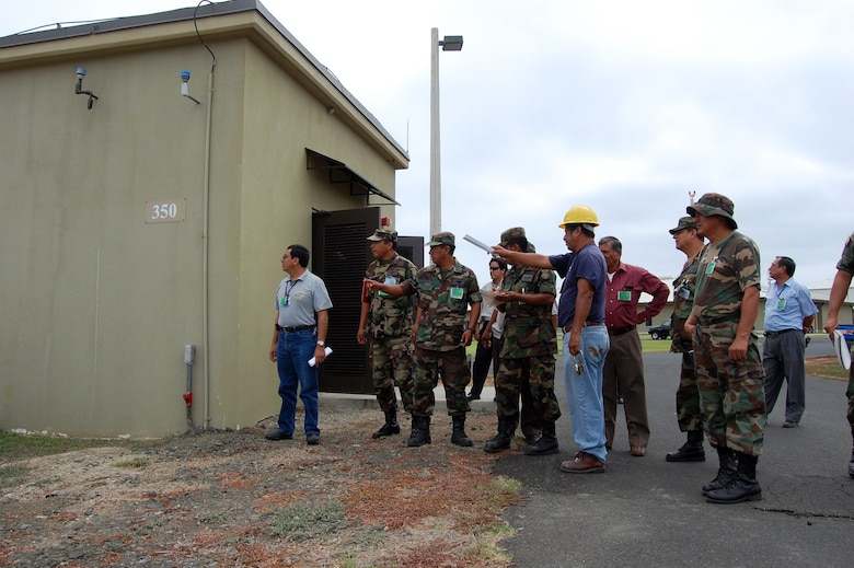 Mr. Pedro Plua (yellow hat), contract employee with ITT, walks government of Ecuador personnel through generator equipment during a FOL Manta orientation June 3. (U.S. Air Force photo by 1st Lt. Beth Woodward)