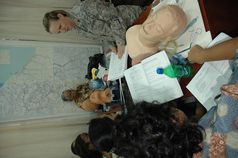 Capt. Kimberly Reed (right), chief, clinical operations for the Defense Institute for Medical Operations at Brooks City Base, Texas, leads classroom instruction during the first responders course taught in Georgetown, Guyana June 1-5. (U.S. Air Force Photo by Kevin Walston)