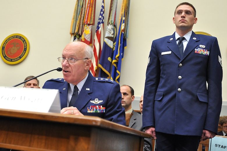 Staff Sgt. Weston Chadwick, 115th Aircraft Maintenance Squadron, stands behind Lt. Gen. Harry Wyatt, the Director of the Air National Guard, at an Armed Services House Committee that addressed the Air Sovereignty Alert Mission. (Photo: Courtesy)