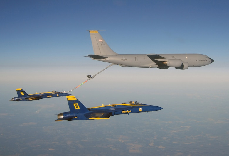 "Two Navy Blue Angel FA-18s  with a KC-135R from the Iowa Air National Guards 185th Air Refueling Wing. The185th AKA ""The Bats"" is refueling the Blue Angels while on their way back to Pensacola Naval Air Station following a Sunday Air Show in Wisconsin."