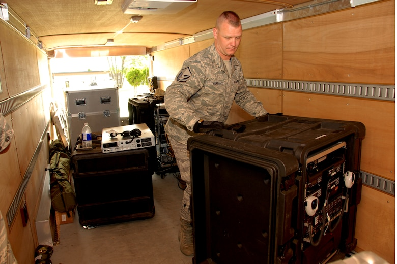 US Air Force Master Sgt. Gregory Baird loads pieces of the Joint Incident Site Communications Capability system (JISCC) onto a trailer at Hancock Field in Syracuse, NY, on June 7, 2009. Baird was loading the JISCC after successful training with the 174th Fighter Wings Communications Flight. (US Air Force photo courtesy of the 174th Fighter Wing Public Affairs Office/Released)