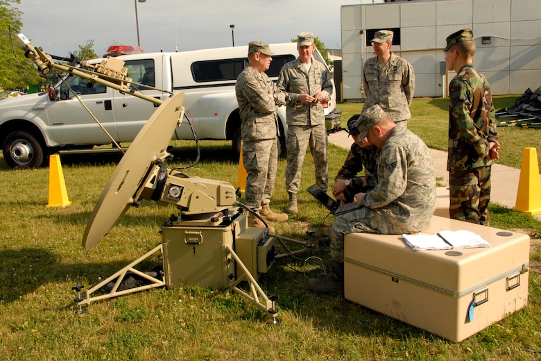 174th Fighter Wing, New York Air National Guard, Commander Col. Kevin W. Bradley meets with members of the 174th Fighter Wing's Communications Flight at Hancock Field in Syracuse, NY, on June 7, 2009. Bradley was being updated on the abilities of the Joint Incident Site Communications Capability system (JISCC). (US Air Force photo courtesy of the 174th Fighter Wing Public Affairs Office/Released)