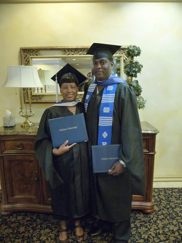 Natasha Green (left), 95th Force Support Squadron Human Resource specialist, and her husband, Kenneth Green, 95th Communications Group planning and implementation computer scientist, graduated during a ceremony at Club Muroc June 6. Mrs. Green graduated with a Master of Arts in Management and Leadership at Webster University-Edwards campus. Mrs. Green was diagnosed with early stage of breast cancer during her first year in graduate school and is now cancer-free. (Courtesy photo)