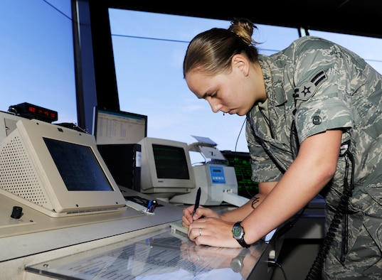 Airman 1st Class Ashley Heidel, a 19th Operations Support Squadron air traffic control journeyman, issues clearance to departuring aircrafts in the control tower at Little Rock Air Force Base June 9, 2009. (US Air Force photo by Airman Lausanne Pacheco)