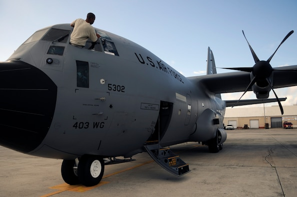 Staff Sgt. Karon Evans washes the flight deck windows on a Hurricane Hunter WC-130J Hercules before a training mission leaving St. Croix, V.I. Sergeant Evans is a crew chief assigned to the 403rd Wing from Keesler Air Force Base, Miss. The training mission covered the Air Force Reserve Command's weather reconnaissance mission. (U.S. Air Force photo/Staff Sgt. Desiree N. Palacios)