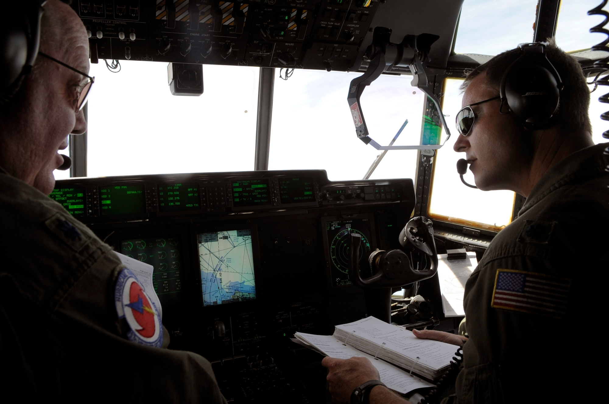 Lt. Col. Roger Gardner and Lt. Col. Louis Patriquin review a checklist during a training mission on a WC-130J Hercules to St. Croix, V.I. from Keesler Air Force Base, Miss. Colonel Gardner is the aircraft commander and Colonel Patriquin is the 403rd Operations Group commander. The mission covered the Air Force Reserve Command's weather mission as they enter Hurricane Season, which began June 1. (U.S. Air Force photo/Staff Sgt. Desiree N. Palacios)